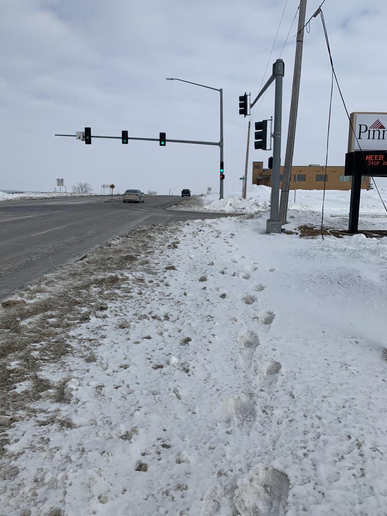 Sidewalk on US 63 at Summitt Street - Looking North